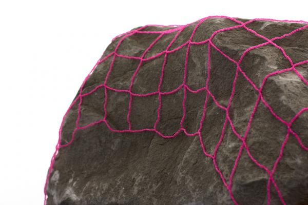 a veil to cover all stones (detail), 2016, Hand beaded net, sandstone boulder, image courtesy of the artist