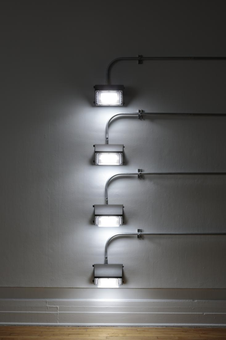 Western Standards K80X4, 2019. Dimension variable. Electrical conduit connected to building's power supply, 4 LED lamps, existing architecture