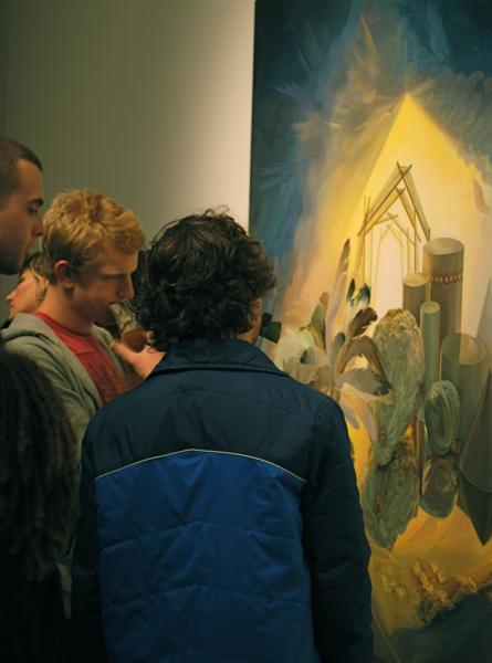 Gallery visitors admiring a painting by Christine Gray